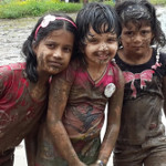 kids playing with mud at picnic