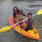 Mother and kids boating at a picnic near pune